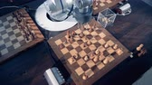 xadrez : Human and robotic arms are moving chess pieces while playing Stock Footage