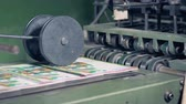 nyomtatott : Printed magazines are being released by a conveyor belt and then getting under a rolling press Stock mozgókép