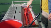 polygraphy : A man is preparing red paint for printing machine