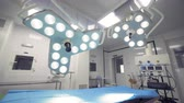 operational : Operational lamps in a hospital room are getting turned on, then off and on again