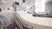 movable : Modern hospital bed in a fully-equipped hospital ward