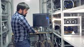 etherium : IT engineer working in cryptocurrency mining factory. Industrial mining farm for bitcoin and cryptocurrency money.