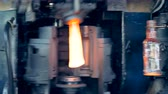 inventário : Industrial furnace is making and releasing glassy bottles