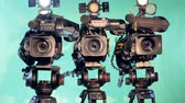 atônito : Three video cameras are standing in a studio Stock Footage