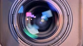 çıktısı : Zooming-out process of a camcorders internal lens in a close up Stok Video