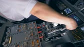 рукоятка : One pilot holds his hand on a plane lever in a flight simulator. 4K.