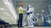 human machine interface : Factory worker switches a robot on, underside view. Stock Footage