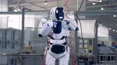 itself : White cyborg uses a special instrument to repair itself. 4K.
