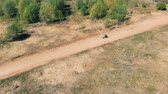 offroad : Motorcycle rider goes on a straight track, top view.