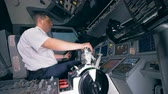 captain : Professional pilot is moving a control wheel and a lever during the flight Stock Footage