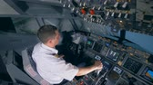 captain : Flight instructor is performing a descent working with a flight simulator