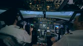 sivil : Professional pilot is giving instructions to an amateur while taking off in a flight simulator