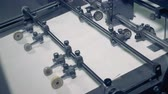 brochura : Sheets of paper go on a conveyor, close up. Paper recycle process. Stock Footage