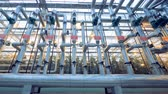 на линии : Wide angle view of a pipeline system in a glasshouse
