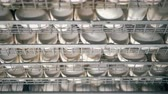 henhouse : Close up of latticed metal containers filled with fresh white eggs
