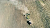 kısa ve kolsuz bluz : Working tractor sows the field, top view. Stok Video