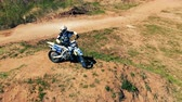 roadster : Panoramic view of a motorcyclist with his bike on a hill. Aerial epic shot. Stock Footage