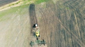 fieldwork : Big tractor rides on a field, top view. Stock Footage