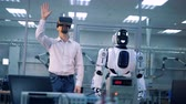 emulator : Male worker and robot make movements with arms. Virtual reality game. Stock Footage