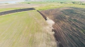 mechanized : Top view of a huge field getting sown by a tractor