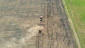 mechanized : Tractor sowing agricultural crops at field. Aerial.
