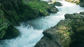 fast river : Rocky canyon with a rapid brook running through it Stock Footage