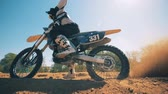 dust : FMX racer starts moving on his motorcycle Stock Footage