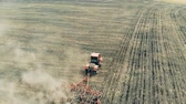 mechanized : Sowing process performed by a field engine on a vast terrain Stock Footage