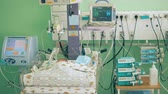 obstetrics : Neonatal unit with medical equipment and a sleeping baby