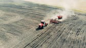 mechanized : Seedbeds are getting sown by a field engine in top view Stock Footage