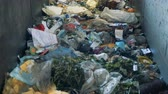recycling plant : Lots of household litter on a line, close up. Factory line is full of moving garbage. Stock Footage