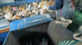 atık : People throw away unrecyclable materials, close up. Workers sort trash, throwing away unrecyclable papers. Stok Video