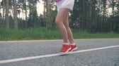 tutmak : Front view of young womans lower body during running process. Healthy lifestyle concept. Stok Video