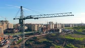 workforce : Building lot with a lifting crane standing in it Stock Footage