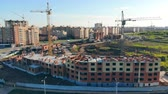 agency : Panoramic view of an urban community getting built. Construction Site At Sunset.