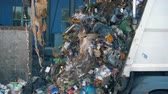 переработаны : Plenty of rubbish is pouring out from a truck. Environmental pollution concept.