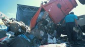 hazardous waste : Litter is getting discarded from a truck in a scrapyard. Environmental pollution concept.