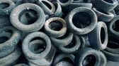 свалили : Plenty of useless wasted machinery tires piled up in a top view