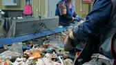 junkyard : Factory personnel is sorting out rubbish on the conveyor belts. Environmental pollution concept.