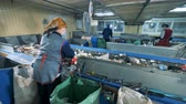 recycling facility : Waste recycling plant. Rubbish utilizing factory and its personnel during working process Stock Footage