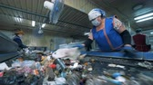 recyklace : Mixed garbage is getting prepared for recycling by female workers