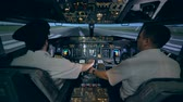 captain : Male pilot is helping his trainee to control the plane simulator. Modern passenger airplane cabin interior. Stock Footage