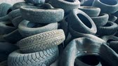 stack : Lots of used tires, close up. Old tires are piled at a dump. 4K.