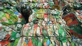 recycling facility : Carton packaging material compressed into tied up cubes for further recycling. Stock Footage