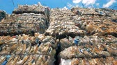 recycling facility : Plastic bottles and polyethylene packed into litter blocks for further recycling. Stock Footage