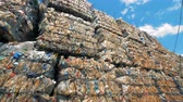 tied up : Plenty stacked trash blocks with plastic ready for further recycling. Stock Footage