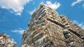 paketlenmiş : Recycling concept. Garbage dumping site with compressed blocks of plastic Stok Video