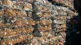tied up : Packs of plastic junk contained in the outdoors waste deposit. Recycle factory. Stock Footage