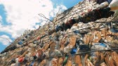 tied up : Plastic garbage compressed into cubical stacks in the open air Stock Footage