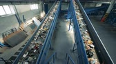 sorting : Rubbish recycling plant with two functioning conveyor belts.